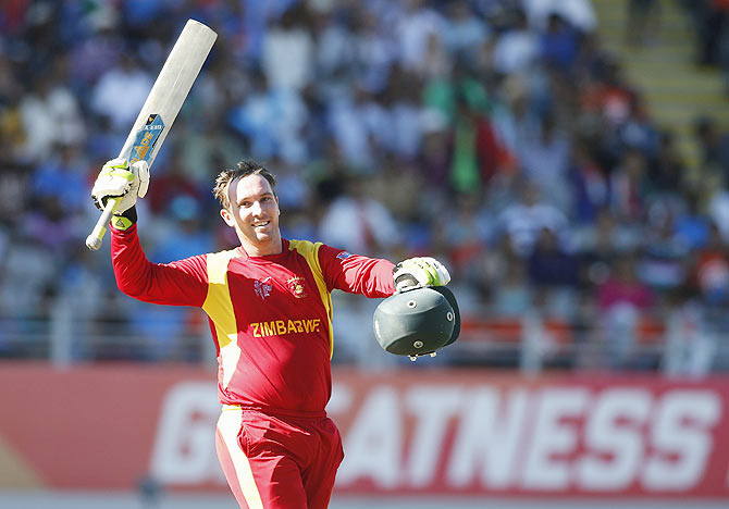 Brendan Taylor of Zimbabwe leads the team off the field at the end of the game against India during the World Cup match at Eden Park in Auckland