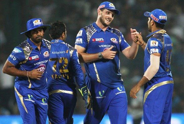 Mitchell McClenaghan of Mumbai Indians is congratulated by his captain Rohit Sharma for getting Angelo Mathews of the Delhi Daredevils out