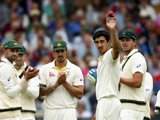 Mitchell Starc holds the ball aloft after claiming his fifth wicket of the innings