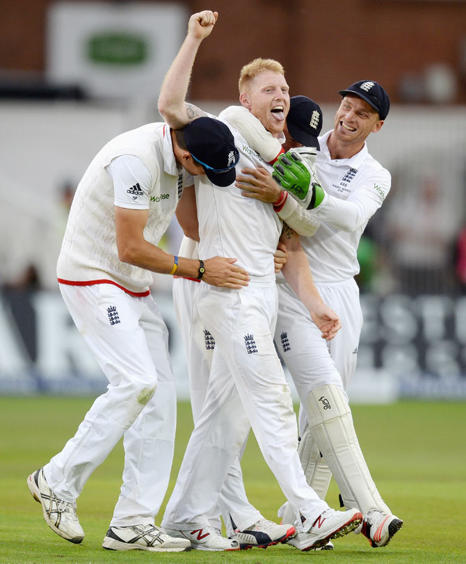 England's Ben Stokes celebrates with teammates Steven Finn and Jos Buttler after dismissing Australia's Mitchell Johnson on Day 2 of the 4th Investec Ashes Test at Trent Bridge in Nottingham on Friday