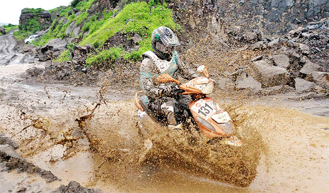 Jodhpur's Abhishek Diwaker astride the Mahindra Rodeo is covered in slush as he rides through the challenging hilly terrain