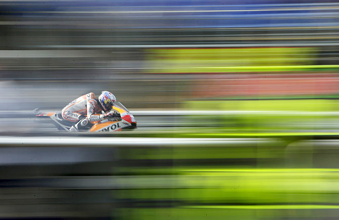 Honda MotoGP's Spainish rider Dani Pedrosa competes during the third free practice of the Czech Grand Prix in Brno, Czech Republic on Saturday, August 15