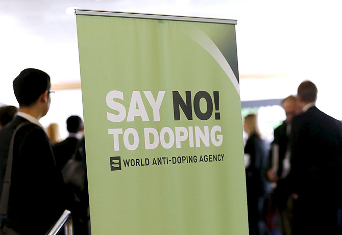 Participants talk before the start of the World Anti-Doping Agency (WADA) Symposium for Anti-Doping Organizations in Lausanne