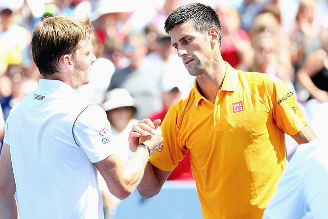 Serbia's Novak Djokovic shakes hands with Belarus' David Goffin after their match