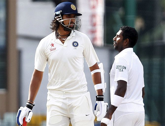 Ishant Sharma argues with Dhammika Prasad on the fourth day of the third Test in Colombo.