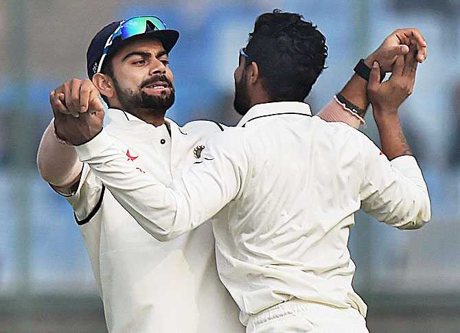 India captain Virat Kohli and his teammate Ravindra Jadeja celebrate the dismissal of Hashim Amla of South Africa during final day of the fourth Test match at Feroz Shah Kotla Stadium in New Delhi on Monday