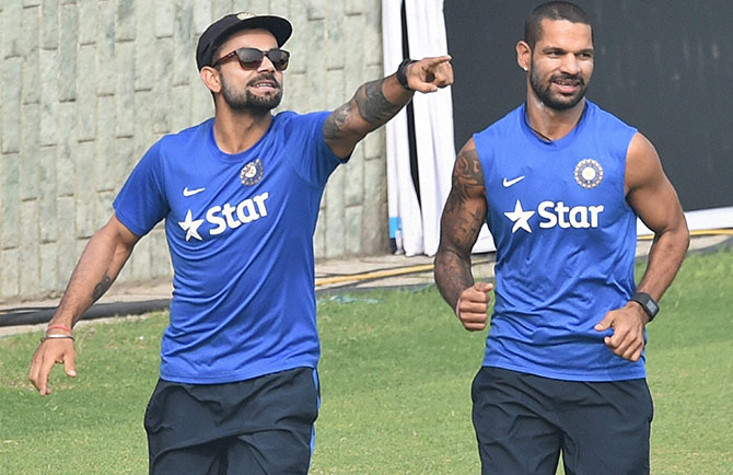 India captain Virat Kohli with Shikhar Dhawan during a practice sesion