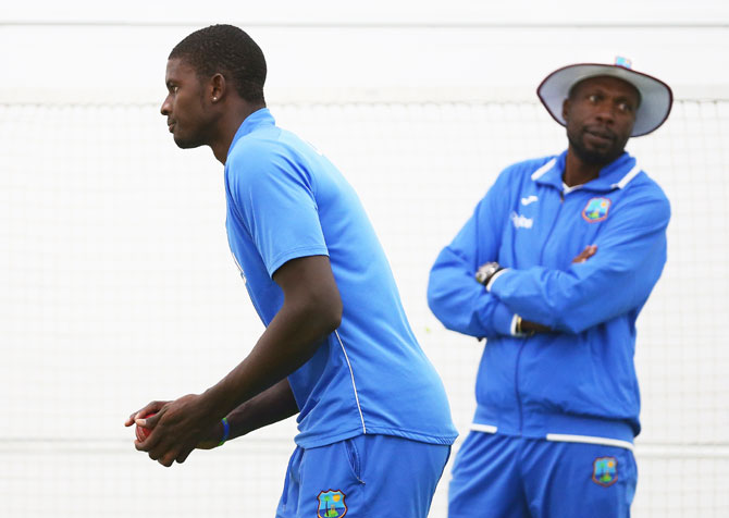 West Indies bowling consultant Courtney Ambrose looks on as Jason Holder bowls in the nets during a West Indies training session at Blundstone Arena in Hobart on Tuesday