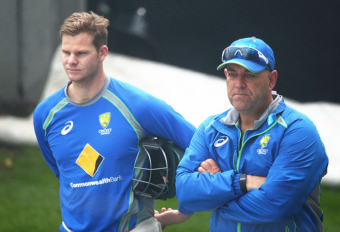 Australia captain Steve Smith and coach Darren Lehmann look on during a nets session at Blundstone Arena in Hobart