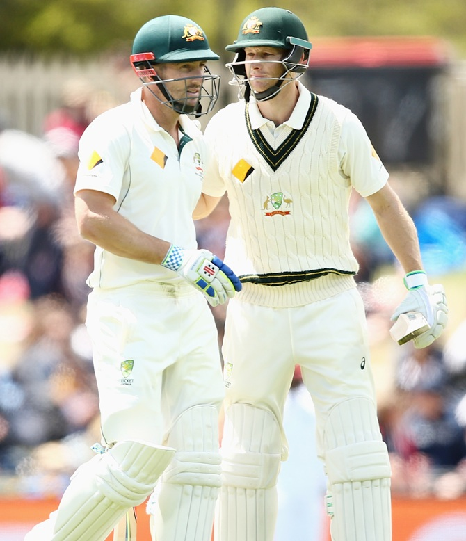 Adam Voges of Australia pats Shaun Marsh