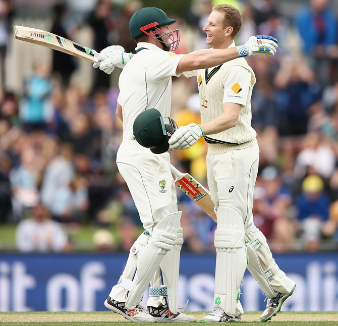 Australia's Adam Voges celebrates with teammate Shaun Marsh