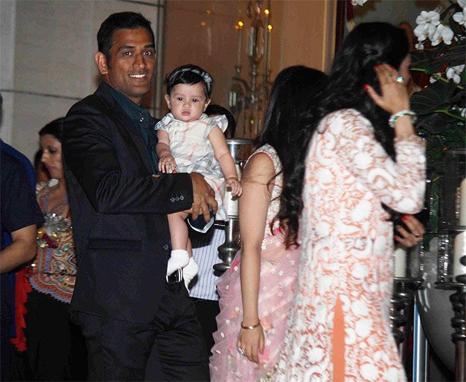 Mahendra Singh Dhoni with his daughter and wife