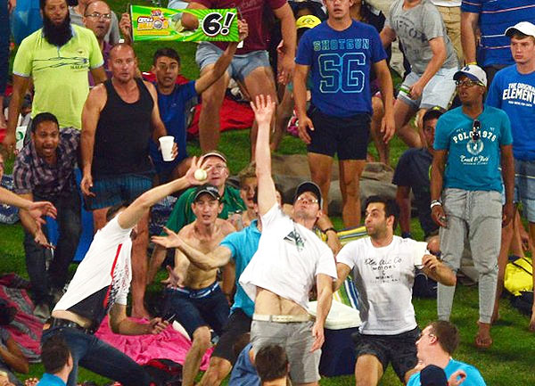 Fans attempt a one-handed catch during the Ram Slam T20 tournament in Centurion. South Africa on Saturday