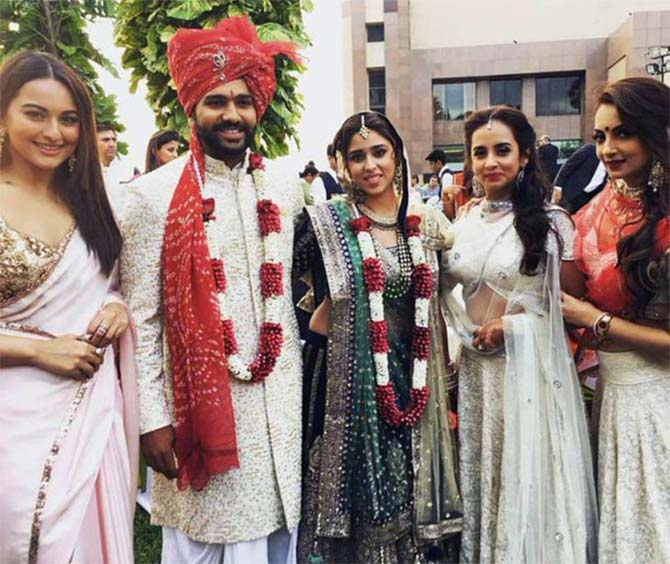 Bollywood actress Sonakshi Sinha poses with the couple