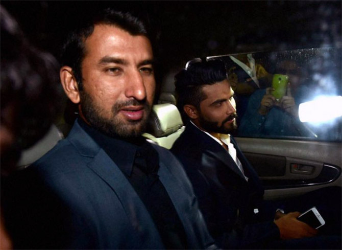 Rohit Sharma's teammates Cheteshwar Pujara (left) and Ravindra Jadeja arrive for the wedding
