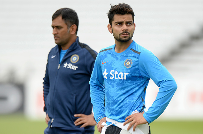 India's Mahendra Singh Dhoni (left) and Virat Kohli attend a training session