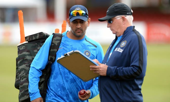 India captain Mahendra Singh Dhoni (left) with head coach Duncan Fletcher