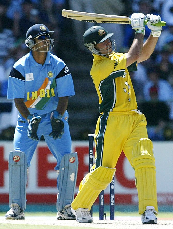 Australia's Ricky Ponting (right) hits a six as India's wicketkeeper, Rahul Dravid, looks on during the 2003 cricket World Cup final at the Wanderers Stadium in Johannesburg