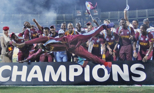 West Indies' Chris Gayle jumps as his teammates watch after winning the World Twenty20 in 2012