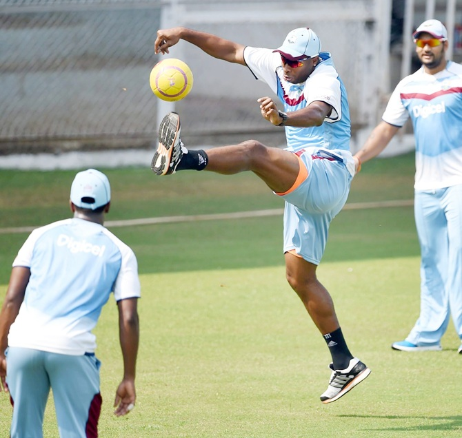 West Indies' players are seen during practice