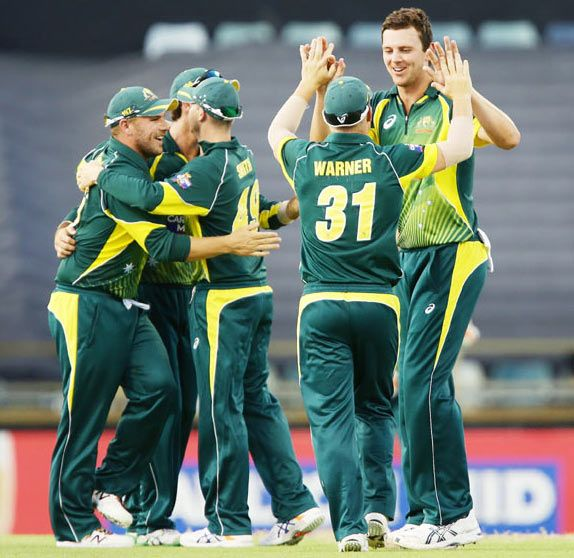 Josh Hazlewood of Australia celebrates with teammates after taking a wicket