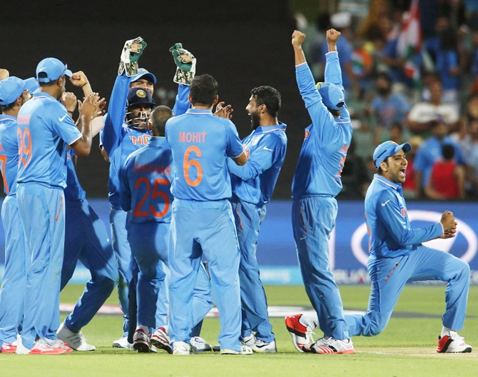 The Indian team celebrates its win. Photograph: David Gray/Reuters