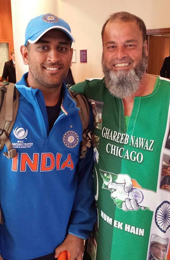 India captain Mahendra Singh Dhoni with Mohammad Bashir