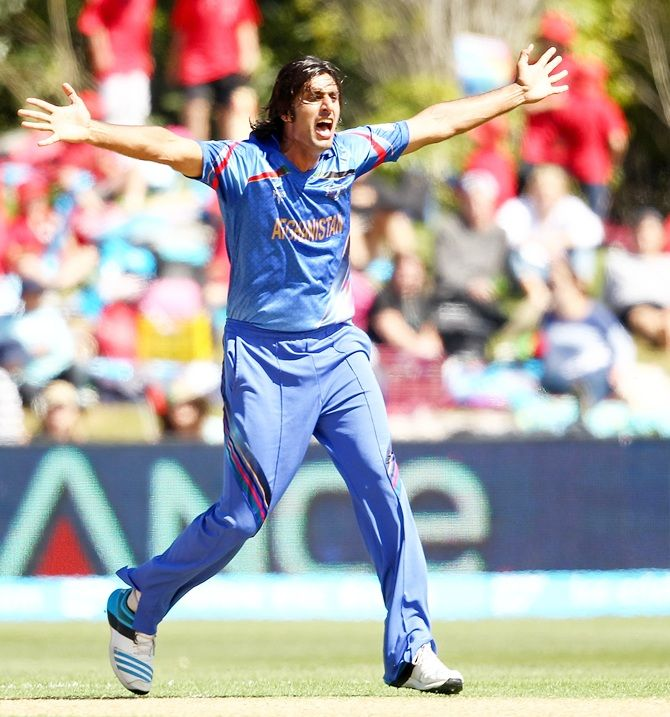 Shapoor Zadran of Afghanistan celebrates a wicket