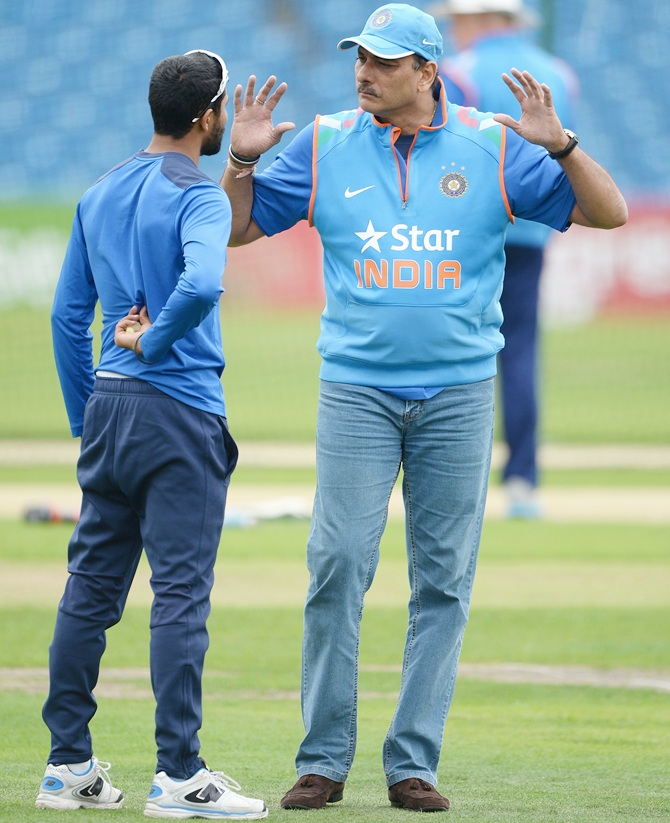 Ravi Shastri with Ravindra Jadeja during a nets session. Photograph: Gareth Copley/Getty Images