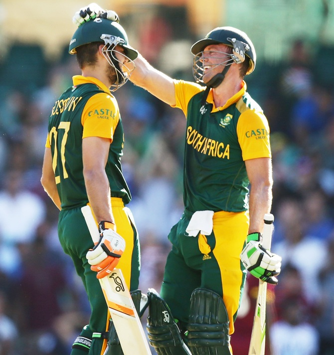 Rilee Rossouw, left, of South Africa celebrates with AB de Villiers after scoring a half century