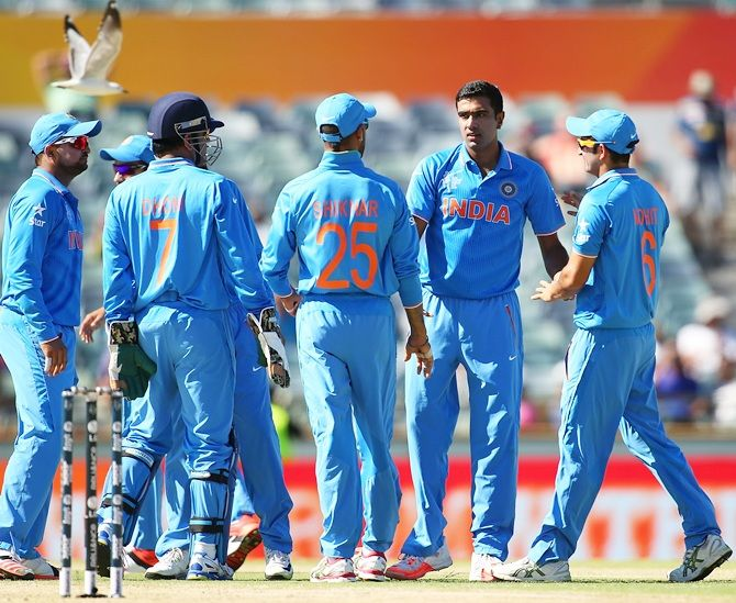India skipper Mahendra Singh Dhoni celebrates with Ravichandran Ashwin
