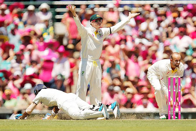 Steven Smith gestures as Lokesh Rahul of India runs to his crease during a run-out attempt