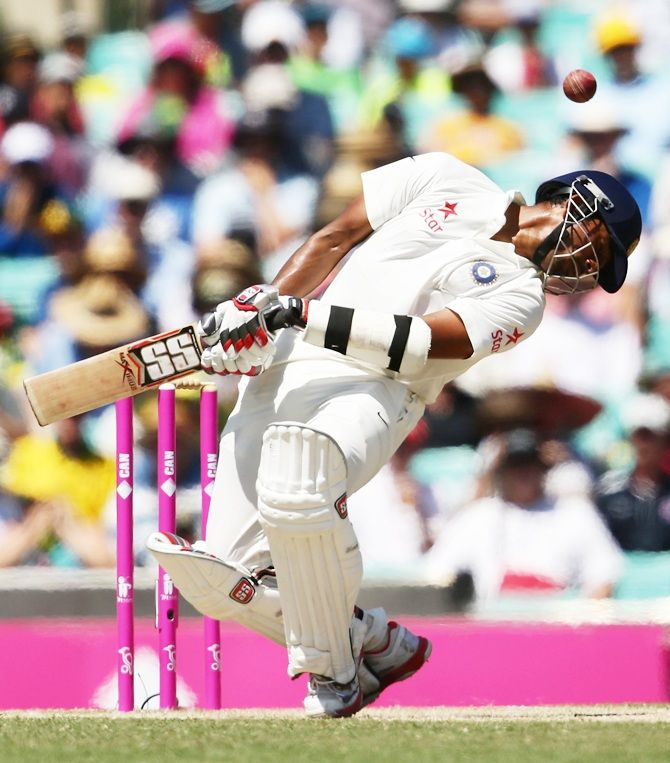 Wriddhiman Saha of India ducks under a high delivery from Mitchell Starc of Australia