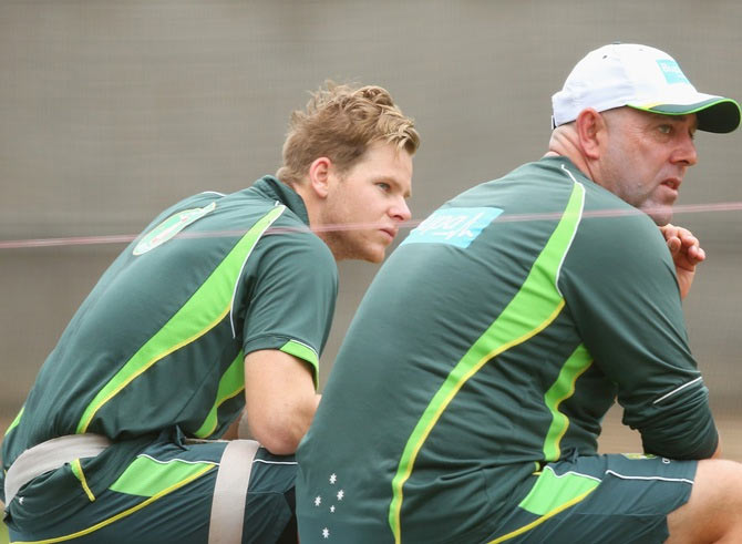 Steven Smith and Darren Lehmann the coach of Australia look on during an Australian training session