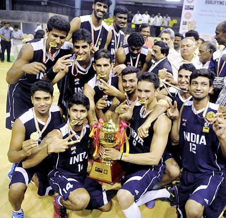 Indian basketball players celebrate after defeating Sri Lanka in final of the 4th South Asian Basketball championship in Bengaluru on Sunday