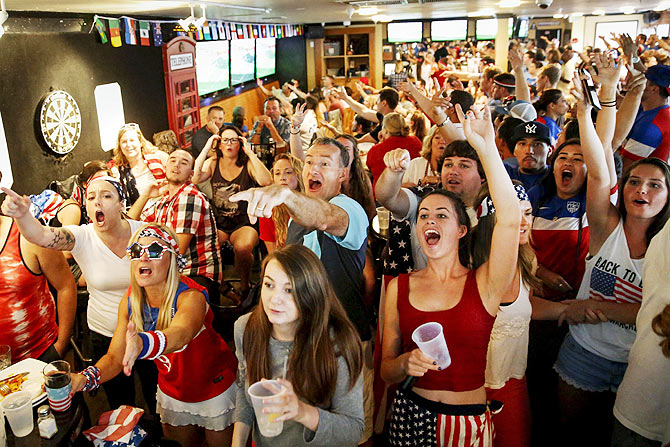 US fans react as they watch the Women's World Cup final match between USA and Japan, at the Underground Pub and Grill in Hermosa Beach, California on Sunday