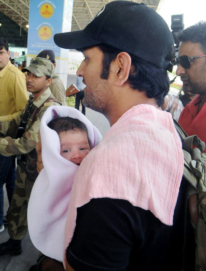 Mahendra Singh Dhoni with his daughter, Ziva, at Birsa Munda International Airport, in Ranchi