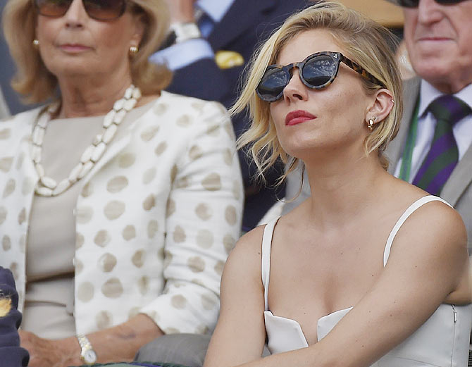 Hollywood actor Sienna Miller on Centre Court watches the Wimbledon semi-final in London on July 10