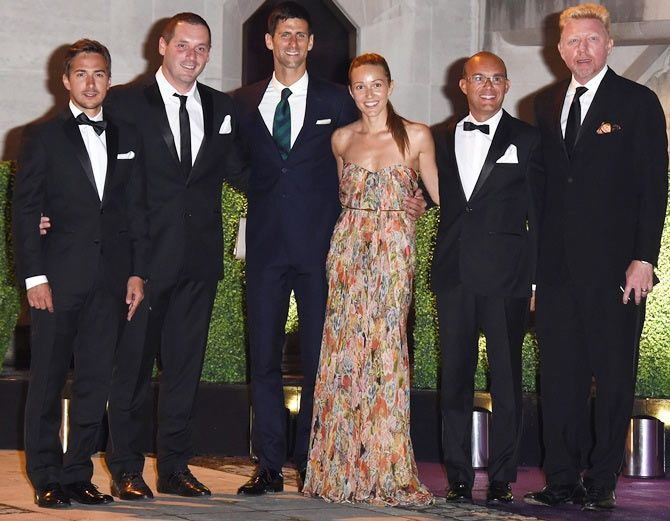 Novak Djokovic (4th from left), wife Jelena Ristic, Boris Becker (right) and guests attend the Wimbledon Champions Dinner at The Guildhall