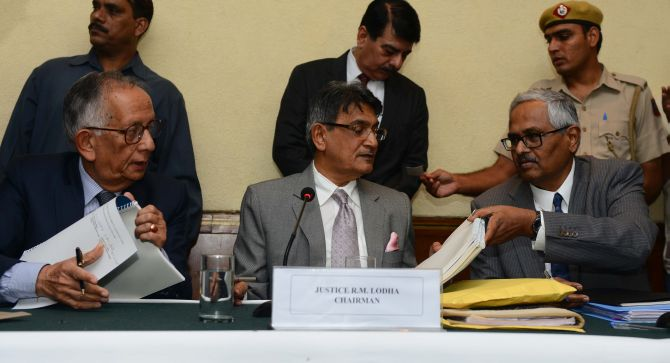 Justice RM Lodha (centre) signs the verdict in the Indian Premier League spot-fixing probe in July 2015