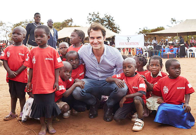 Roger Federer with the children in a village in Malawi