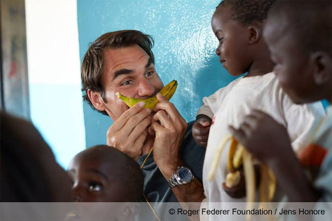 Swiss tennis giant Roger Federer jokes around with kids at his charity event in Malawi on Monday