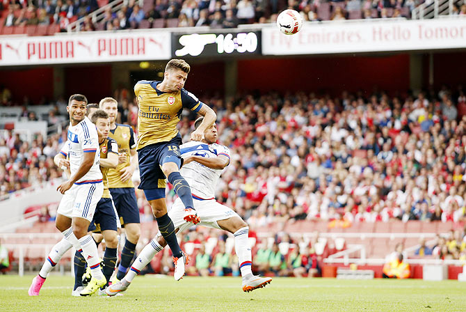 Arsenal's Olivier Giroud scores their first goal against Olympique Lyonnais during the Emirates Cup Pre-Season friendly tournament at Emirates Stadium in London on Saturday