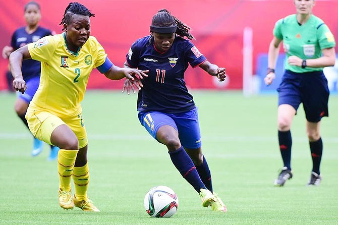 Cameroon defender Christine Manie (left) and Ecuador forward Monica Quinteros (11) vie for possession
