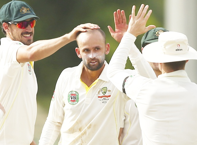 Australia's Nathan Lyon, centre, celebrates after taking a wicket