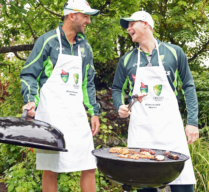 Nathan Lyon, left, and Steve Smith