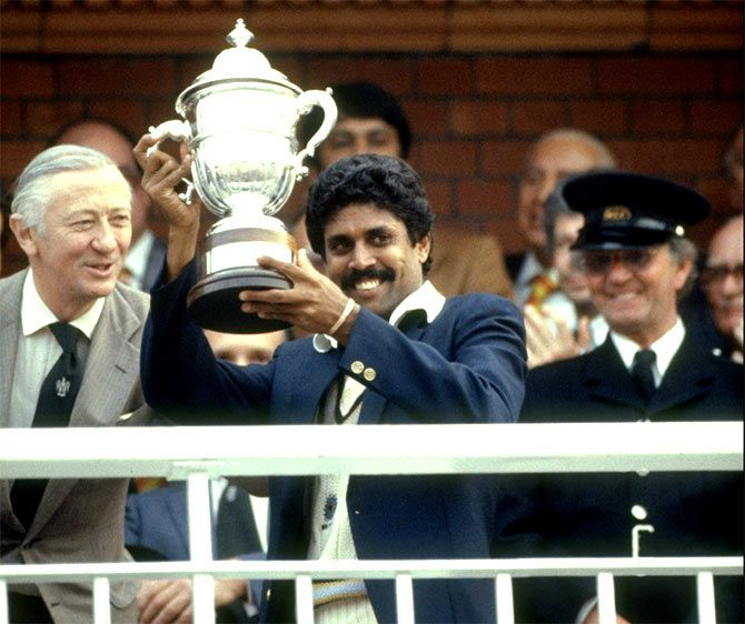 Captain Kapil Dev holds aloft the trophy after India won the 1983 World Cup