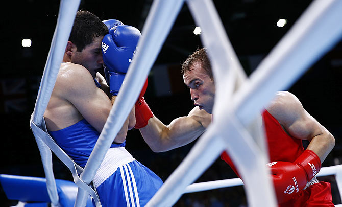 Azerbaijan's Parviz Baghirov (left) and Russia's Alexander Besputin fight during their men's 69kg Welter weight boxing gold medal fight at the 1st European Games in Baku, Azerbaijan, on June 27