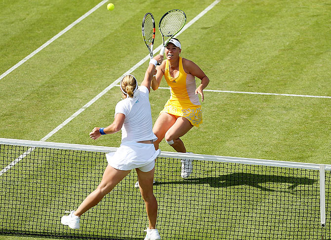 Denmark's Caroline Wozniacki lobs the ball over Russia's Svetlana Kuznetsova during their third round match of the Aegon International at Devonshire Park in Eastbourne, England, on June 24