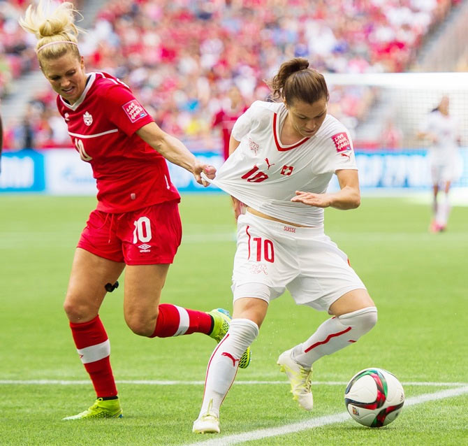 Switzerland's Ramona Bachmann (right) is challenged by Canada's Lauren Sesselmann during their FIFA Women's World Cup match in Canada on June 22